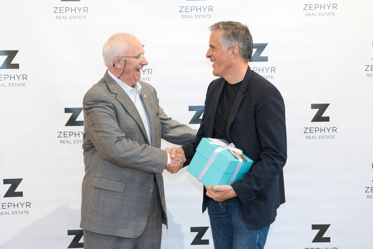 Founder Bill Drypolcher of Zephyr Real Estate congratulates Ken Eggers