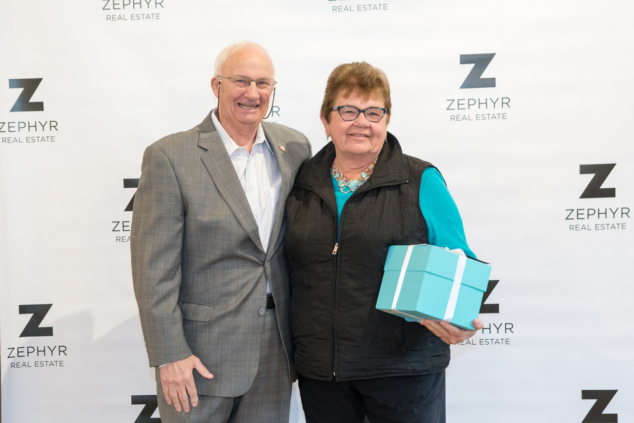 Founder Bill Drypolcher of Zephyr Real Estate congratulates Joan Loeffler