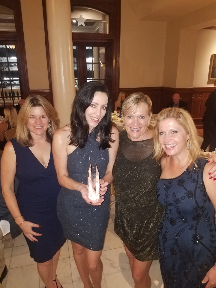 Pictured: LIV Sotheby's International Realty awarded 'Best Video Marketing' from Luxury Real Estate. From left to right: Malia Cox Nobrega, Kristen Muller, Katie Williams, Melanie Frank