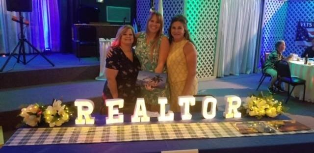 Lorie Leal with American Caribbean Real Estate name REALTOR of the Year