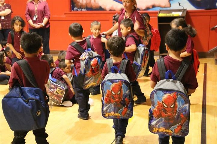 Each of the 600 students at Seward Communication Arts Academy and 150 students through Refugee One received fully stocked backpacks on their first day of school, courtesy of Berkshire Hathaway HomeServices KoenigRubloff Realty Group.