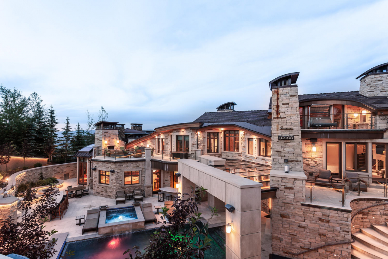 Designed by renowned architect, Michael Upwall, 9828 N Summit View Drive is a brilliant combination of mountain luxury, artistic design, entertainment and ski resort access. At over 20,000 square feet, 'Summit House' is truly a resort within a resort as no expense was spared in the concept, design and construction of this estate.