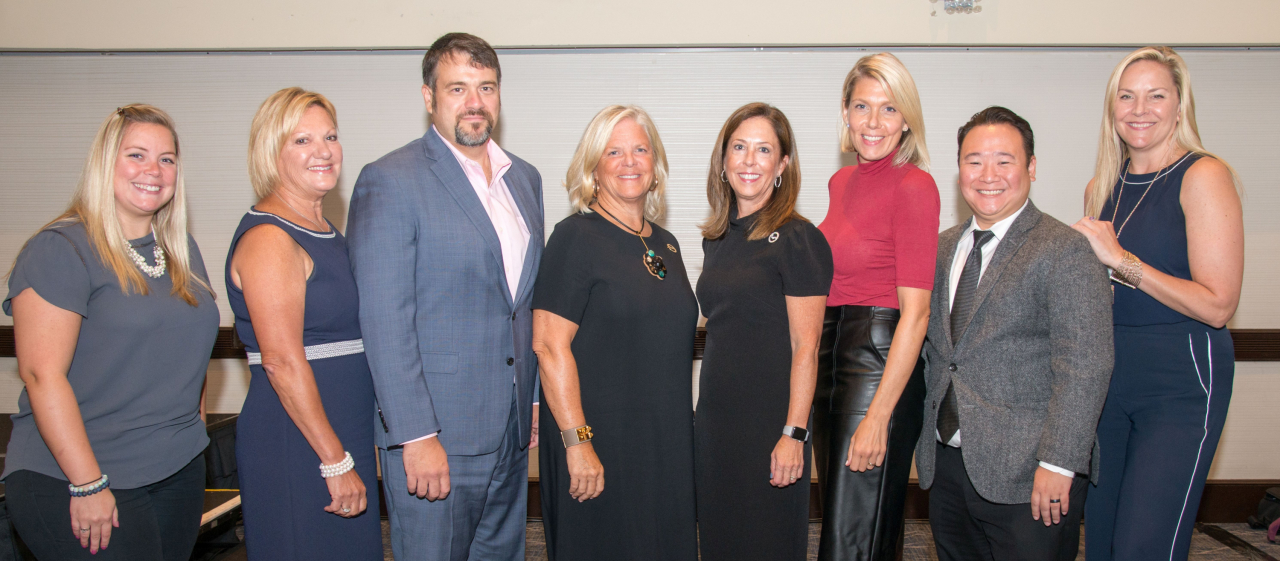 "The marketing department at Daniel Gale Sotheby's International Realty, one of the nation's leading realtors, recently held a series of ""Back to School,"" and ""Tech Day"" meetings, developed to support and bolster agent success during the busy fall selling season.   Pictured here with CEO Deirdre O'Connell (center right) and COO Deborah Hauser (center left) are (l-r) marketing department managers Patty Hasselbring, Susan Poli, Jason Miller, Katherine Cirelli, S.J. Yun and Abby Sheeline."
