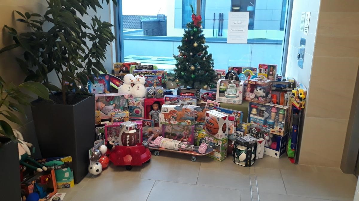 Top Colorado luxury real estate brokerage collected over 100 toys for children living at Bluff Lake, as well as 96 gifts for Colorado single mothers and 36 families with Be the Gift