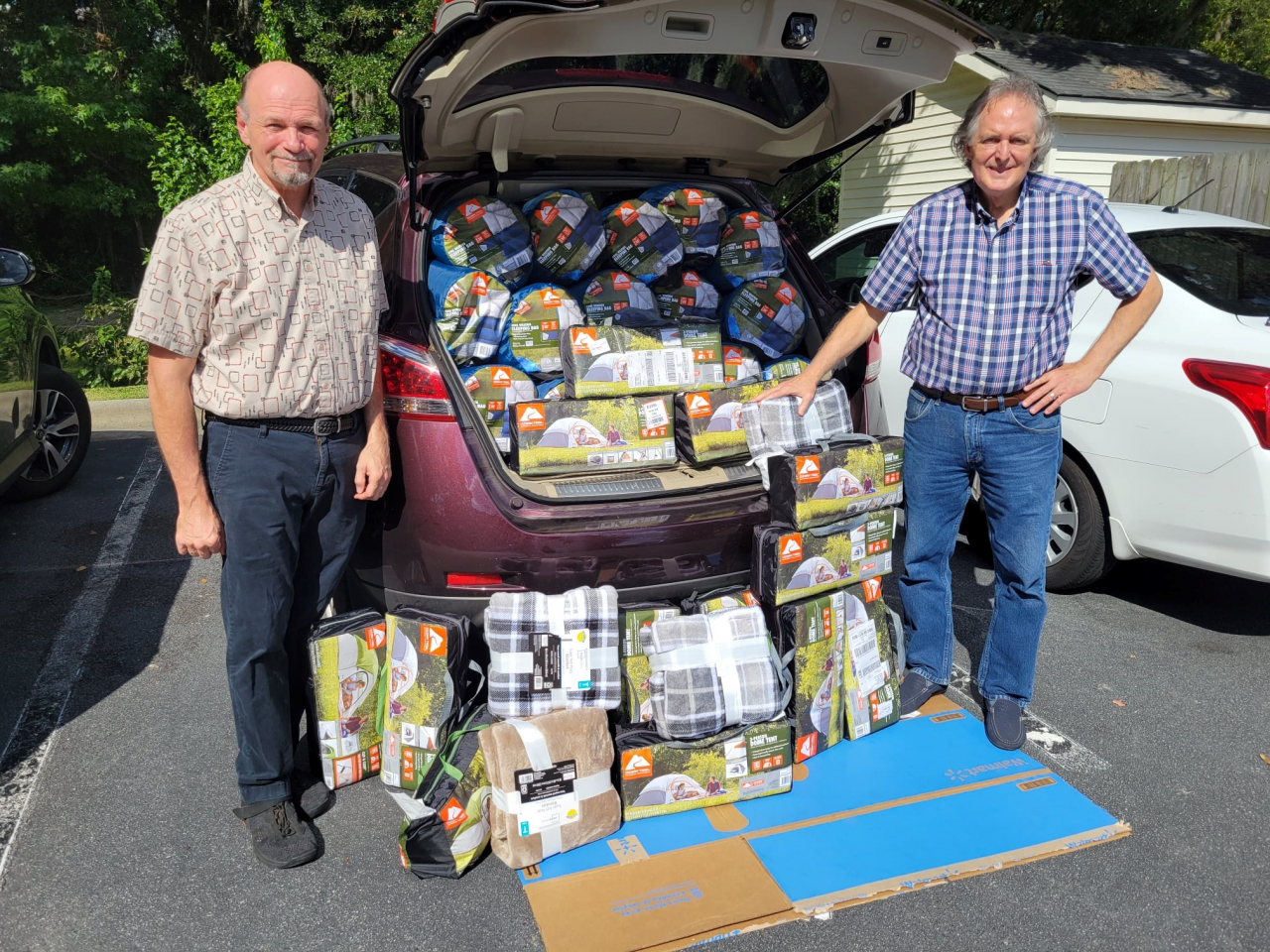 Seabolt Real Estate Sales Associates Craig Simpson and Michael Brannin (l-r) recently donated tents, sleeping bags and blankets to help local individuals and families experiencing homelessness in Savannah, GA for the fifth consecutive year.