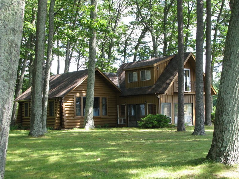 Sandy point pigeon lake ontario canada for Log cabin sunrooms